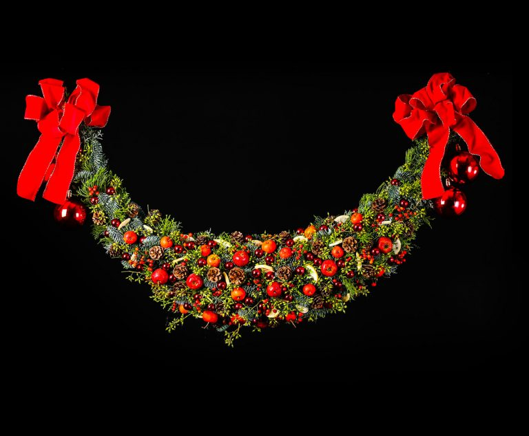 Another classical Christmas decoration is a garland. Also decorated in traditional red and green.